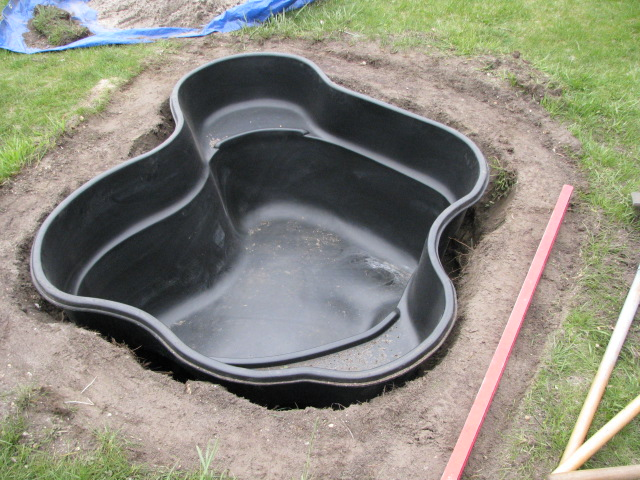This small goldfish pond is seen being installed in the for Small goldfish pond