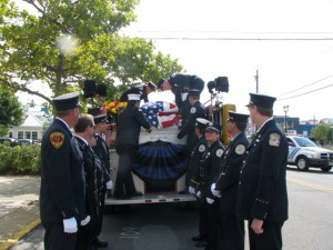 Members of Station 44, The Seaside Heights Volunteer Fire Department serve as pallbearers to past Chief Gerry Graichen.